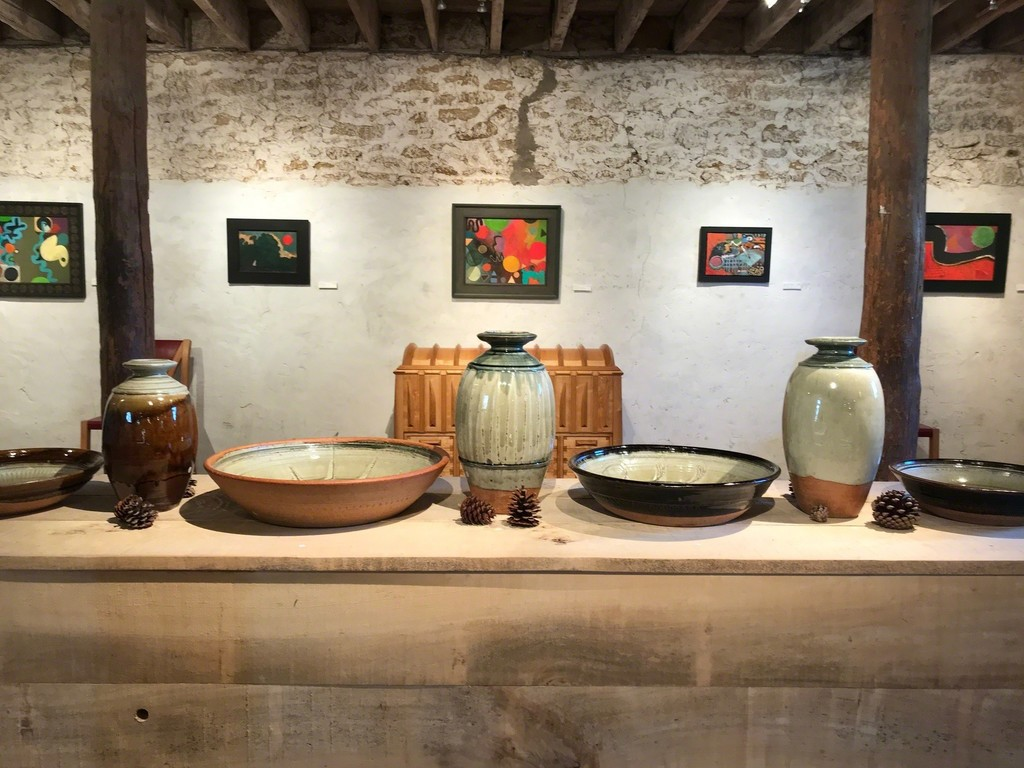 Richard Batterham's Bottles and Fruit Dishes in front of Alfred Stockham's paintings