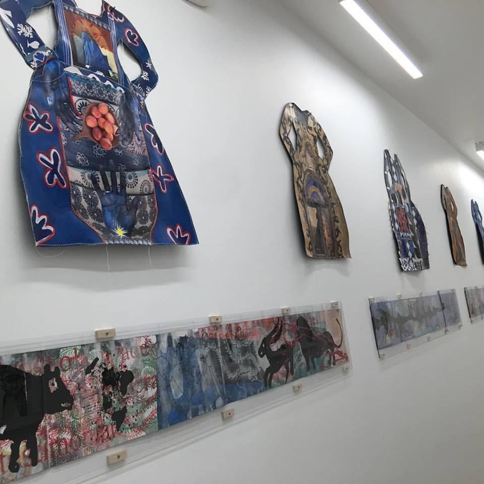 "Janet Taylor Pickett cut-out Dresses with Cuban artist Ibrahim Miranda's ""Invisible Garden, Insular Night"" mixed-media works on maps of Cuba. These two artists live each other's art & they really look amazing together."