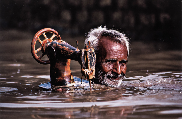 Steve McCurry, 'Tailor Carrying his Sewing Machine, Porbandar, India', 1983-printed later, Skinner
