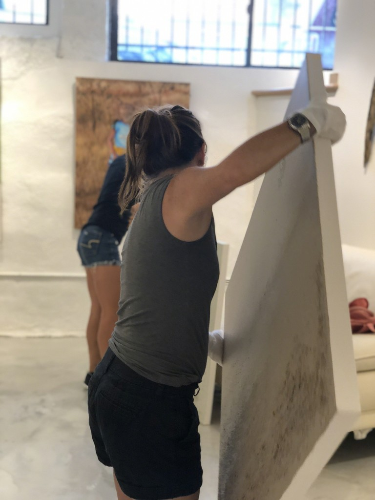 Artists Wendy Shapiro and Raquel Fornasaro helping to hang Be Here Now