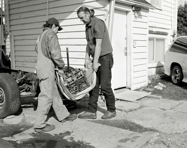 , 'Men move an engine block,' 2008, Gagosian