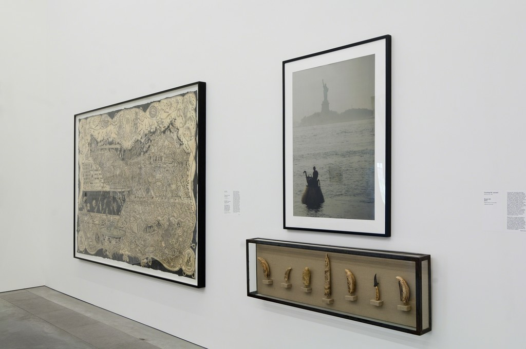 "(L to R) Installation view of ""Duke Riley's Curtains for the Free World"" (2007), ""Photograph of Duke Riley in The Acorn Submarine"" (2007), and ""Items Salvaged from Vessel: Whale's teeth believed to have been engraved by Gordon David while inside The Acorn vessel"" (2007) as part of special exhibition ""Radical Seafaring"" on view at the Parrish Art Museum, Water Mill, New York, May 8 – July 24, 2016. Photo: Gary Mamay"