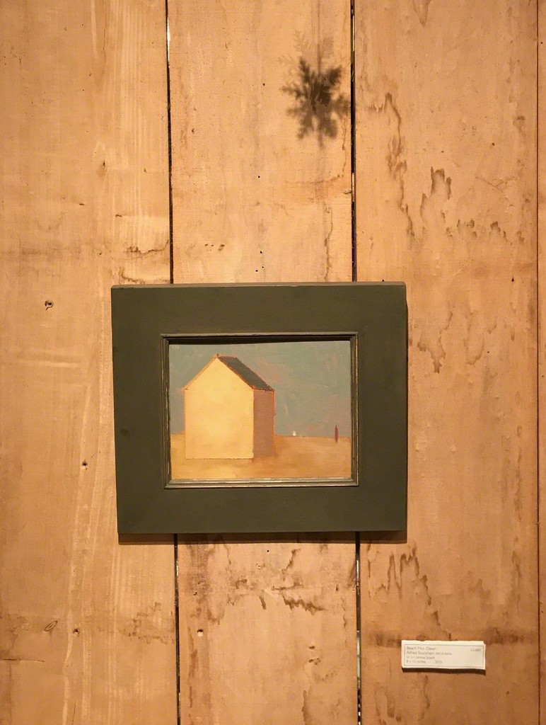 Beach Hut, Dawn by Alfred Stockham RCA RWA on the wooden wall with shadow