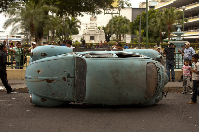 ", 'VW Beetle from the performance ""Overturned VW"",' 2014, Museo de Arte de El Salvador (MARTE) and MARTE Contemporary (MARTE-C)"