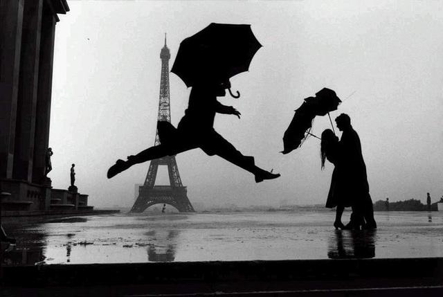 Elliott Erwitt, 'France. Paris (Umbrella Jump)', 1989, Lumiere Brothers Gallery