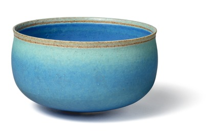 Circular stoneware bowl, decorated in azure glaze with turquoise green elements.