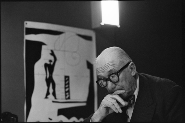 "René Burri, 'FRANCE. Ile-de-France region. Paris. 1959. 7th arrondissement. 35, rue de Sèvres.  The painter, architect and city planner LE CORBUSIER in the ""Atelier 35 S"".  On the left: a lithograph of his ""Modulor"".', 1959, Magnum Photos"