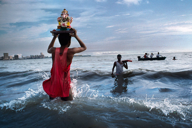 , 'Devotee carries statue of Lord Ganesh into the waters of the Arabian Sea during the immersion ritual off Chowpatty beach, Mumbai, India,' 1993, Sundaram Tagore Gallery