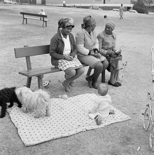 David Goldblatt, 'Baby with child-minders and dogs in the Alexandra Street Park, Hillbrow', 1972, Photography, Silver gelatin on fibre-based paper, Goodman Gallery