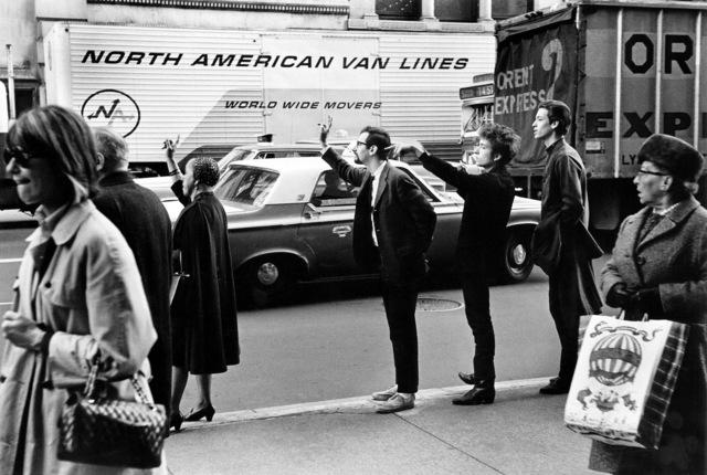 , 'Bob Dylan, Peter Yarrow, & John Hammond Jr. Hailing Taxi, NYC,' 1965, TASCHEN