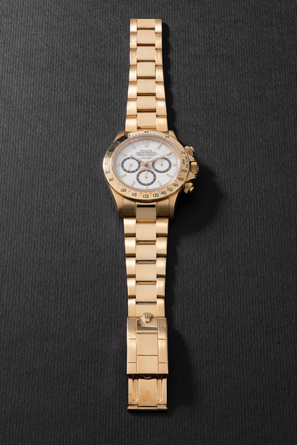 """Rolex, 'A fine and very rare yellow gold chronograph wristwatch with """"Floating Cosmograph"""" white porcelain dial, bracelet, guarantee and presentation box', Circa 1988, Phillips"""