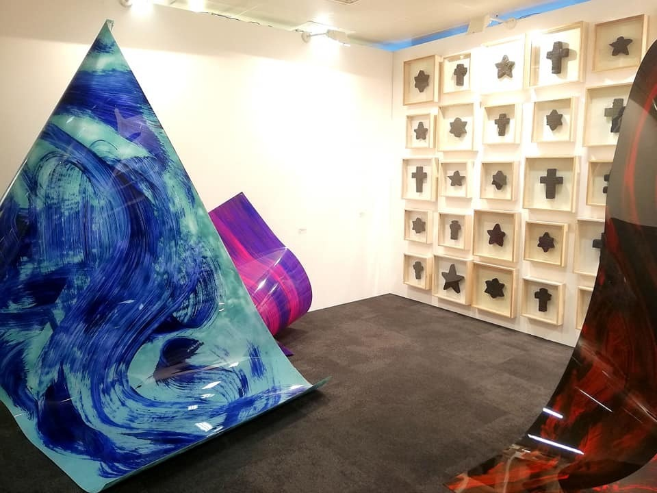 "Fragment of gallery's ""Meno parkas"" (Kaunas / Dusseldorf) booth with artworks by Povilas Ramanauskas and Česlovas Lukenskas. Photography by Povilas Ramanauskas."