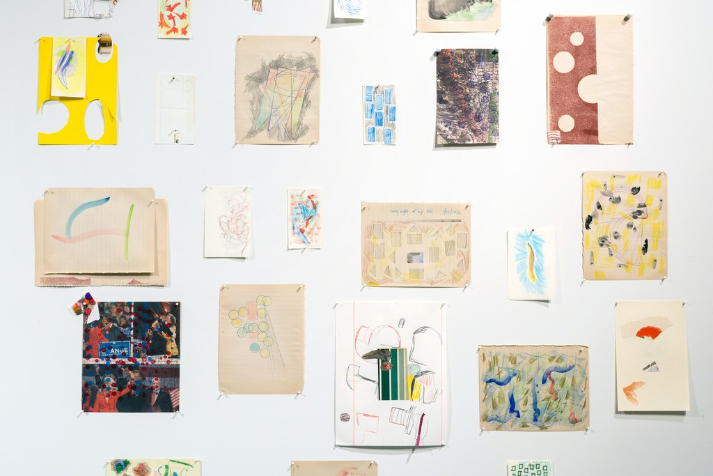 An installation of works on paper by Austin Thomas.
