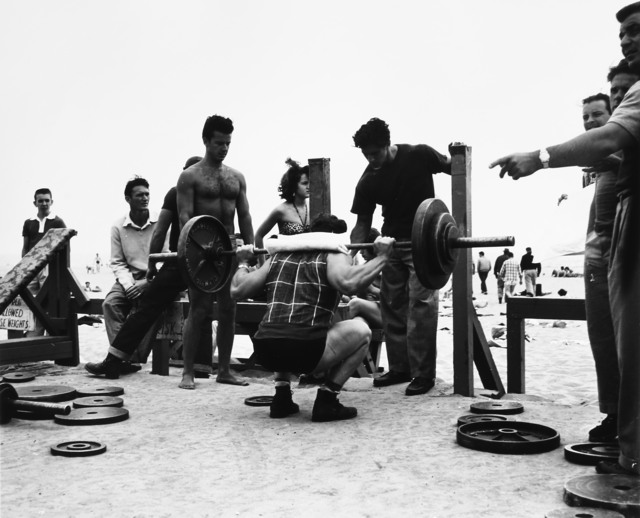 , 'A Body Builder in a Squatting Position, Muscle Beach, Santa Monica, CA,' 1954, Bruce Silverstein Gallery
