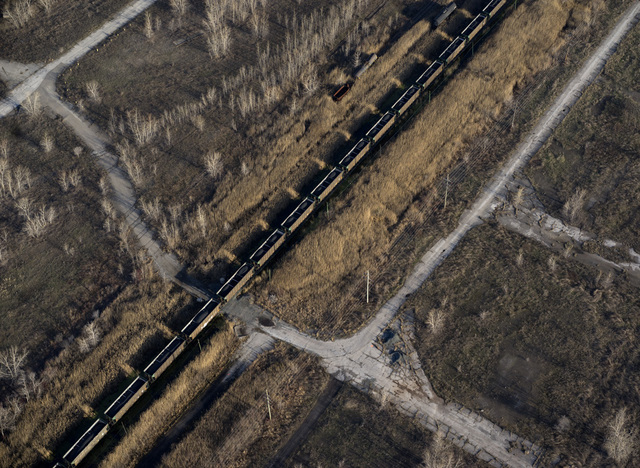 Terry Evans, 'Train loaded with petcoke moving through brown field, site of former steel mill, in Southeast Chicago', 2015, Museum of Contemporary Photography (MoCP)