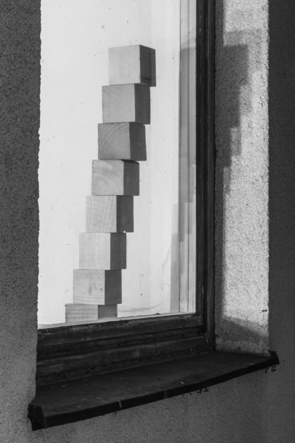, 'Eight wooden blocks arranged to form a stairway behind a window,' 2014, Raster