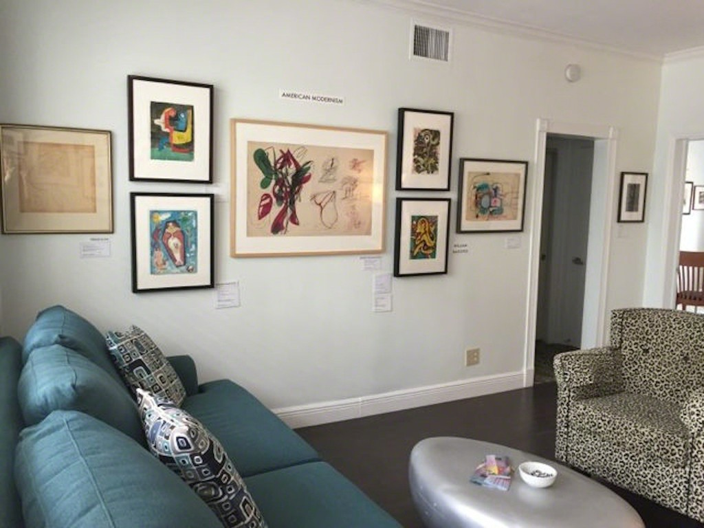 This is the West Wall of our Room 156 last year featuring a drawing by Stanley William Hayter in the center of the grouping. Please note the leopard patterned chair and coffee 'bean' table.