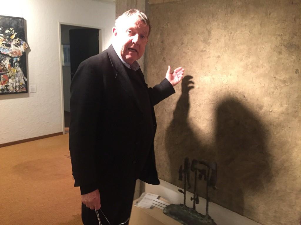 Gilbert Uebersax, the artist, examines his work from 1980