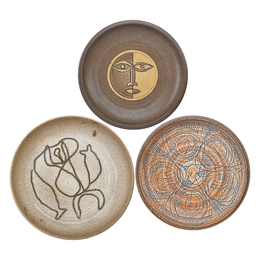 Three stoneware plates