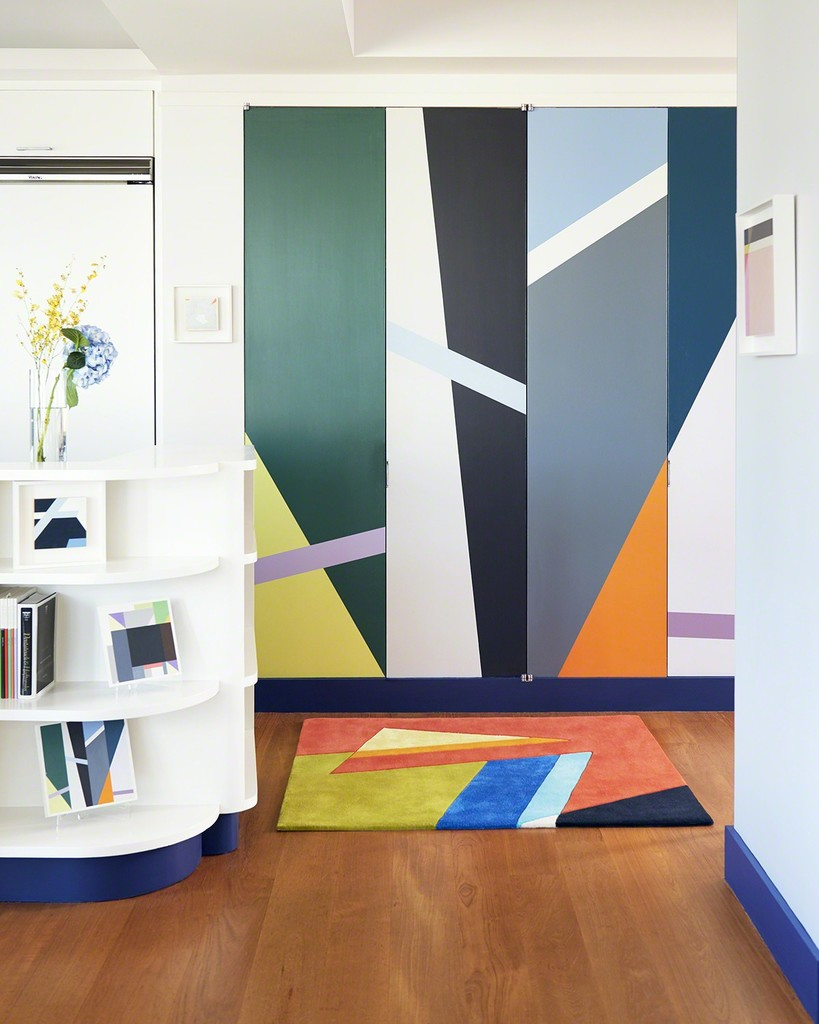 In translating the painting into a rug, Seligson hand-selected the eight colors from hundreds of color poms to ensure precise color matching. The cut-pile rug was hand-tufted in Thailand with pure silk and New Zealand wool.  The pencil carving is also cut by hand.  Behind the rug are a set of doors that are also translated from one of Seligson's paintings. The artist worked with a housepainter, using a maquette which you can see on the left on the bottom shelf. Door price on request.