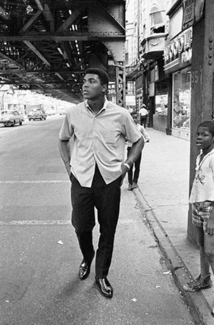 , 'Muhammad Ali Walking in Downtown Chicago,' 1966, CAMERA WORK