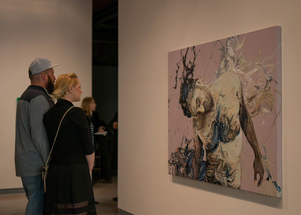 """Visitors at the opening reception viewing """"Transcription 48 (Endeavor)""""."""
