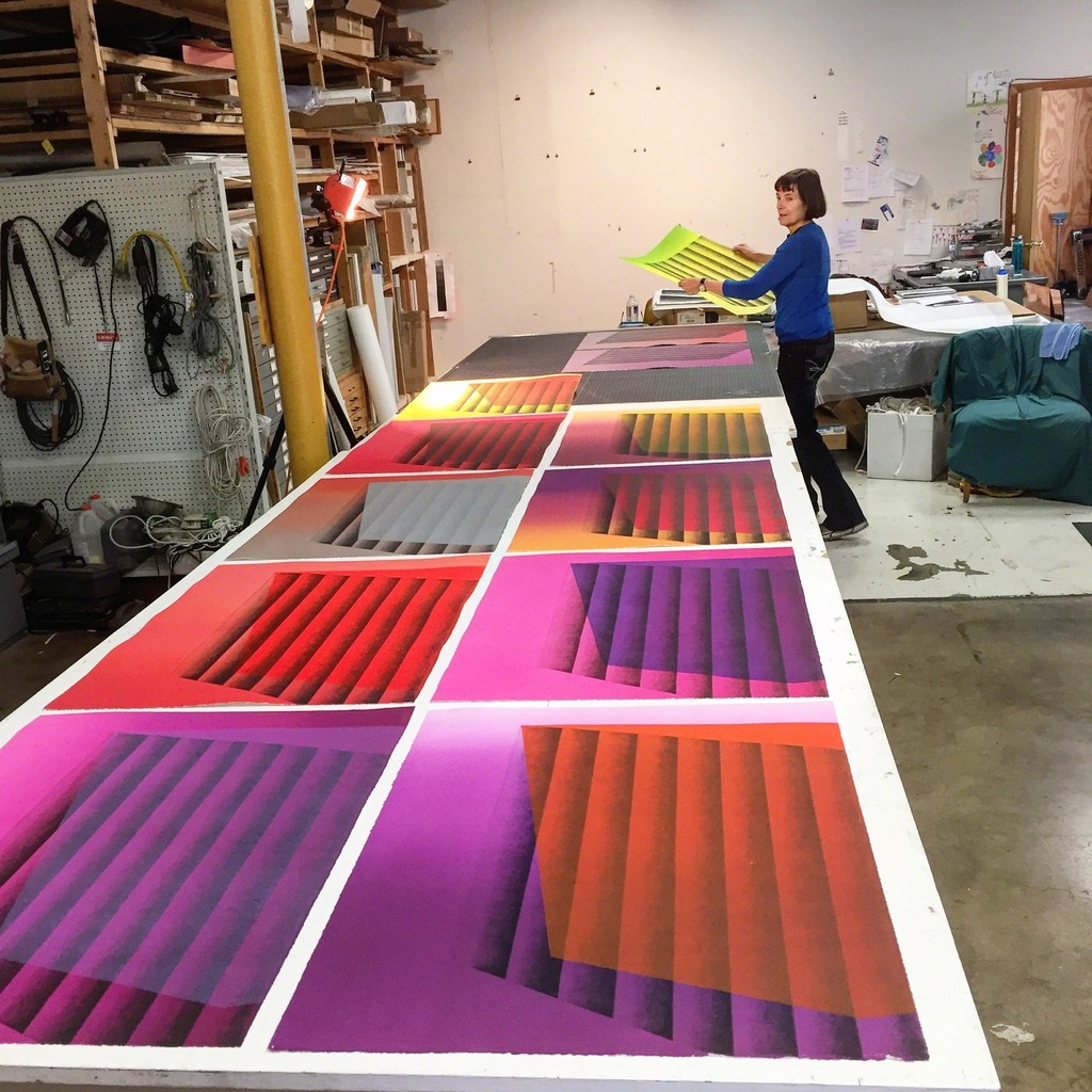 """Kate Petley with her """"Sideways"""" and """"Upside"""" monoprints at Manneken Press, May, 2016."""