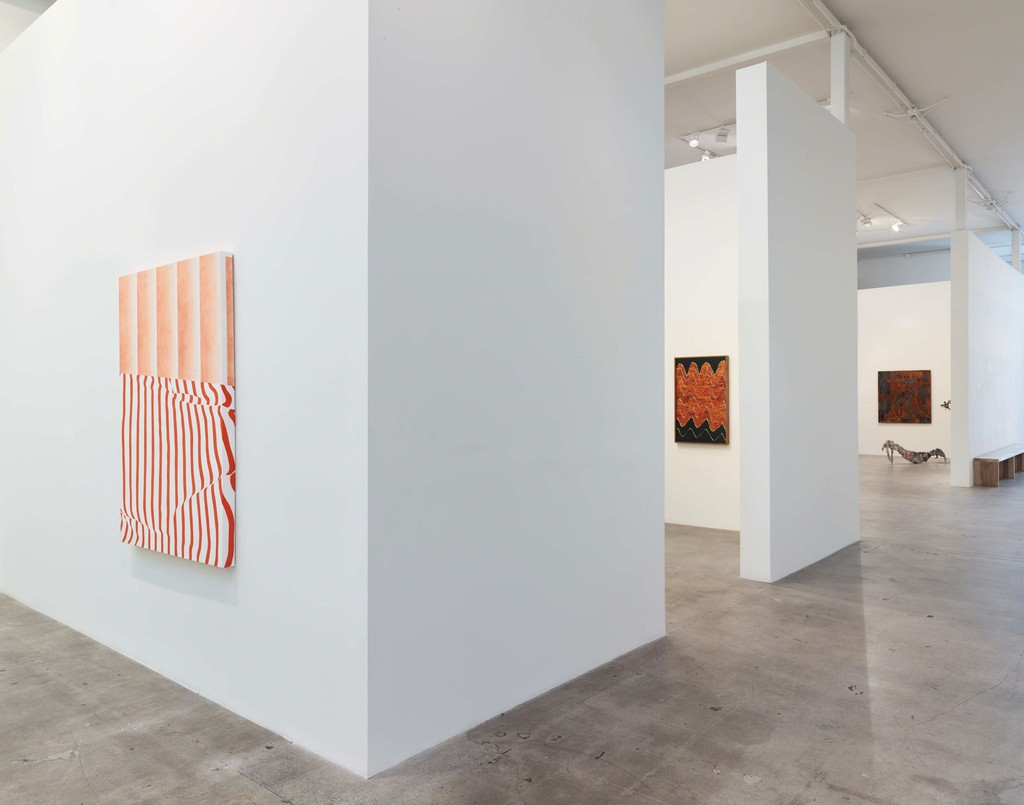"Installation view of ""Transfigured."" with (left) paintings by Sarah Mikenis; (center) photographs by Evan Whale; and (right) paintings and sculpture by Lionel Sabatté"
