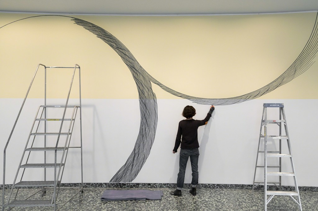 Linn Meyers at work on Our View from Here, 2016, at the Hirshhorn Museum and Sculpture Garden, Smithsonian Institution, Washington, DC . Photo: Cathy Carver