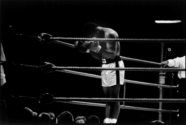 , 'World heavyweight champion Muhammad Ali prays to Allah before the first round of a title fight, London,' 1966, Atlas Gallery