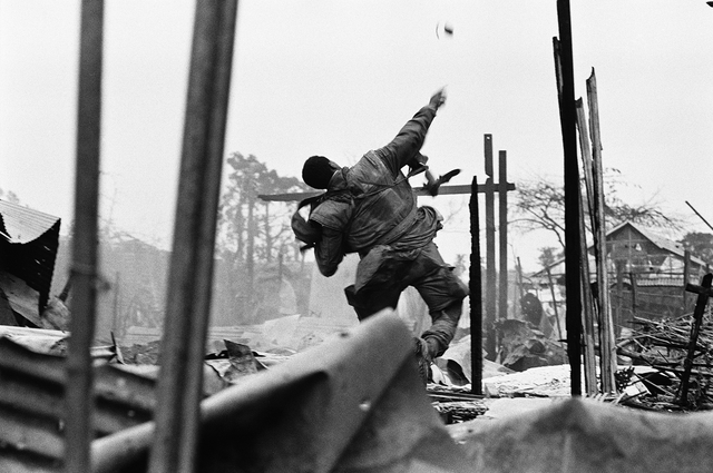 Don McCullin, 'US Marine hurling a grenade seconds before being shot through the left hand, Hue, Vietnam', 1968, Howard Greenberg Gallery