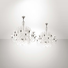 A pair of large chandeliers in Murano glass, metal structure