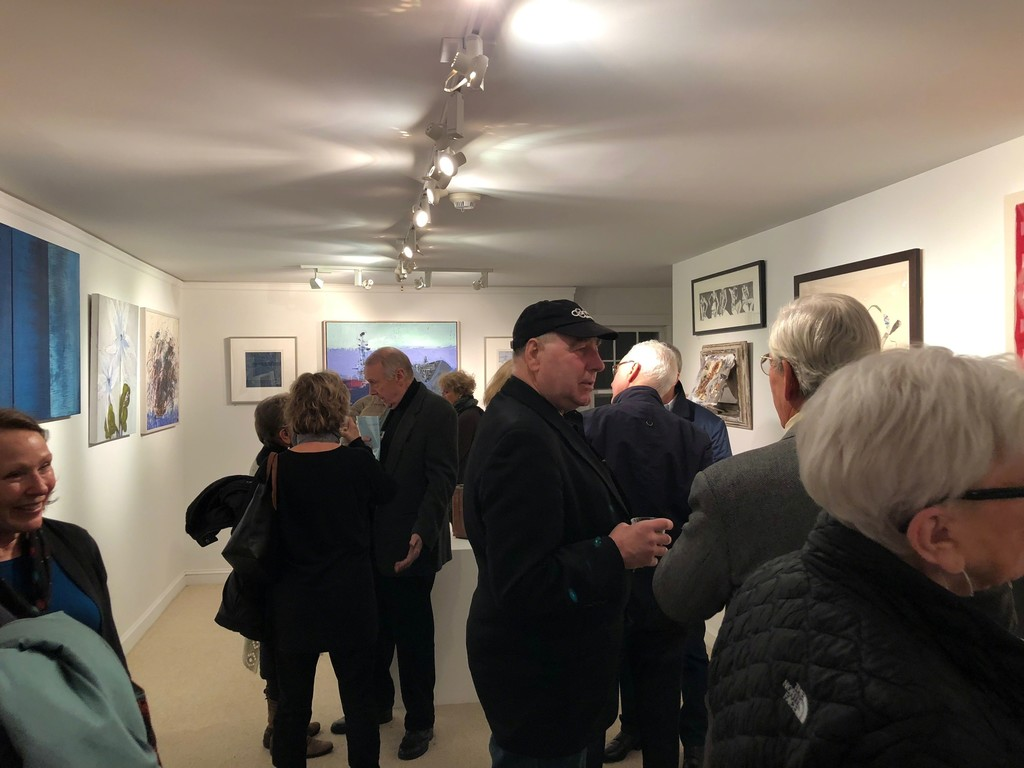 Patrons, friends and artists enjoy the opening reception on December 1st.