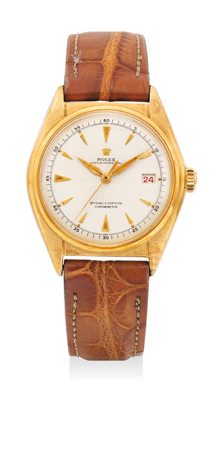 Rolex, 'A fine and early yellow gold wristwatch with center seconds and date', Circa 1948, Phillips