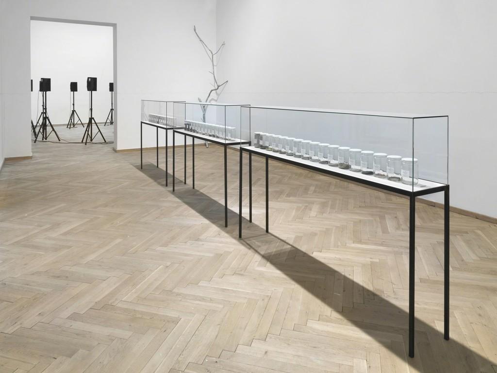 Alicja Kwade, 'Radio (Alicja R-603)' (2014), 'Lampe (Kaiser Idell rot)' (2015), 'Kaminuhr (Zentra)' (2014), 'Parralelwelt (Ast/AntiAst)' (2018), 'NachBild' (2017). Installation view, Kunsthal Charlottenborg 2018. Photo: Roman März. Courtesy the artist, KÖNIG GALERIE, Berlin / London, 303 GALLERY, New York, kamel mennour, Paris / London.