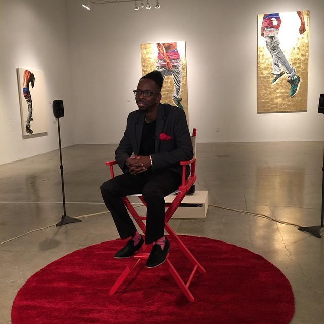 "Artist Fahamu Pecou (seated) ""GRAV-I-TY"" installation at the Museum of Contemporary Art of Georgia (MOCAGA), Atlanta, GA"