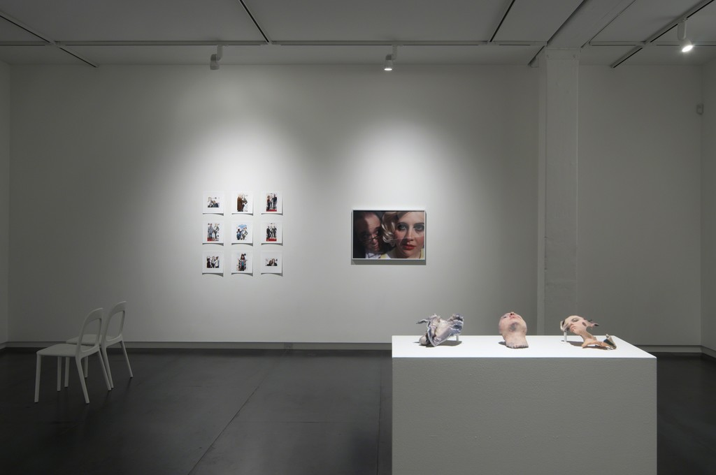 Foreground: 3D-printed triptych by Lorna Barnshaw. Back wall: photographic works by Jordan Rathus. Photo by Worksighted.