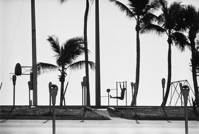 , 'USA. Florida. Fort Lauderdale. Man exercising on a beach, not far from the port where nuclear submarines are stationed. ,' 1966, Magnum Photos