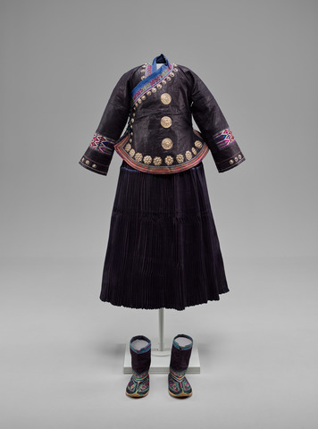 Woman's Jacket, Skirt, and Boots, China, Yunnan Province, Wenxuan Prefecture, Zhuang, mid-20th century. Indigo-dyed cotton coated with egg white or animal blood and beaten, with silk embroidery, metal foil, and silver buttons and ornaments. Yale University Art Gallery, Ann B. Goodman Collection, Gift of Ann B. Goodman.