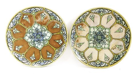 A pair of Royal Doulton stoneware chargers