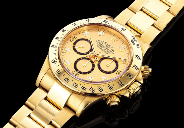 Rolex, 'A fine and attractive yellow gold chronograph wristwatch with bracelet, champagne and diamond-set dial and presentation box', 1991, Phillips