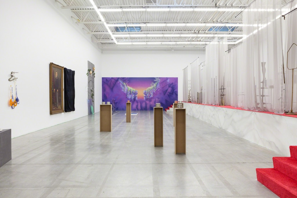 FADE IN: INT. ART GALLERY – DAY, installation view.