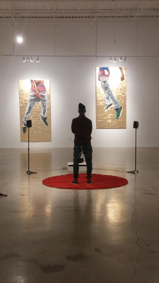 "Artist Fahamu Pecou (standing) ""GRAV-I-TY"" installation at MOCAGA ""Black Boy Fly"" (left) and ""But I'm Fly"" (right)"