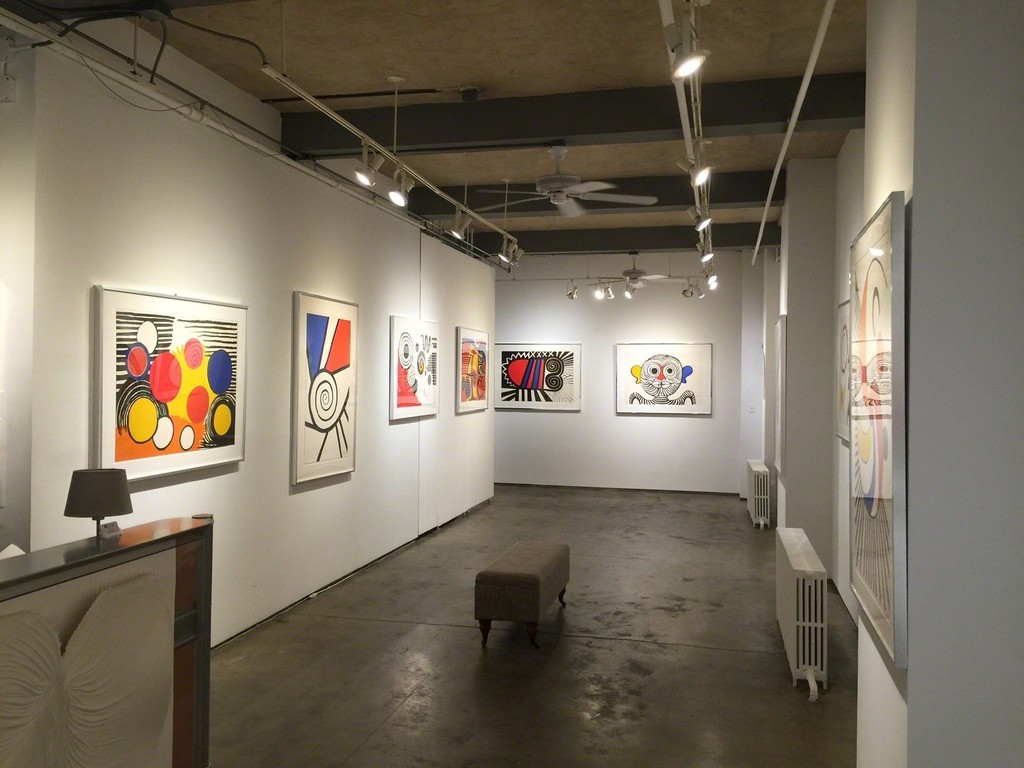 "Lithograph and original watercolor works from Alexander Calder featured in Alexander Calder: Sharing Negative Space.  (Works shown from left to right -""Spirale Rouge & Bleu"", ""The Way of the World"", ""The Letters"",""The Bug"" and ""Kissing Man"" )"