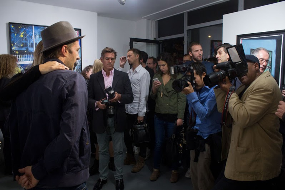 Dan Baldwin and the paparazzi at The Fear of Letting Go Private View