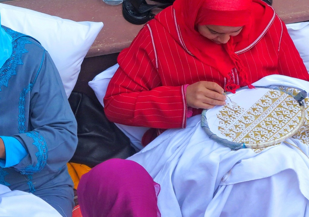 Moroccan embroiderers preparing the canvases for Yassine Mekhnache