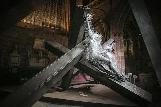 Installation view of David Mach's monumental coat hanger sculpture Golgotha at Chester Cathedral in 2016.