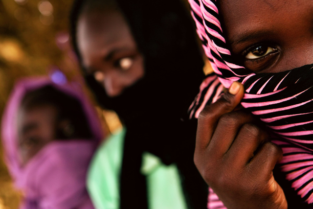 , 'A 12 year old girl (striped scarf) explains how she was separated from her 2 friends, and raped by soldiers from the Sudanese government.,' , Anastasia Photo
