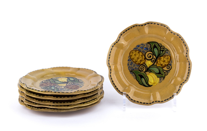 Set of six saucers with vegetable decorations