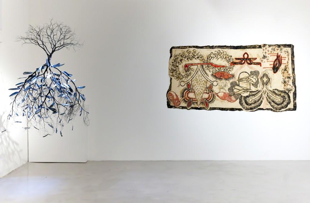 "Jorge Mayet, ""De Yemaya"", 2016, paper maché, wire, feathers and acrylics, 130x80x80cm and Simone Pellegrini, ""Condizioni di fondo"", 2017, mix media, 127x240cm"